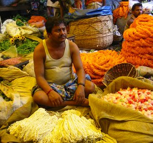 A_seller_at_the_Flower_Market_Calcutta.jpg